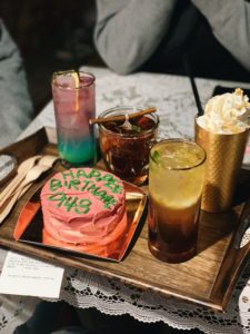Various drinks and cake